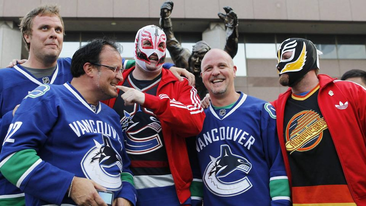 Fans of the Vancouver Canucks pose for a photo before Game 4 of the 2011 Stanley Cup final.