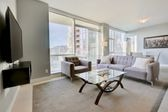 This 919-square-foot two-bedroom unit in the trendy Yaletown district is within walking distance of the sea wall and Granville Island, and has floor-to-ceiling windows with an ocean view.