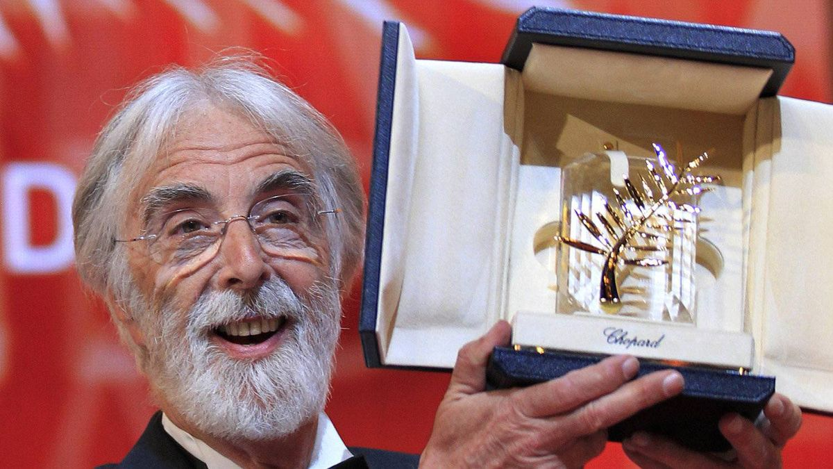 """Director Michael Haneke reacts after receiving the Palme d'Or award for the film """"Amour"""" during the awards ceremony of the 65th Cannes Film Festival, May 27, 2012."""