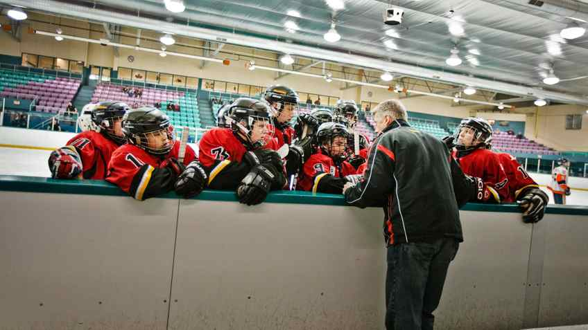"""Rob Anthony coach of the Leaside Flames """"Bantam A"""" hockey team, gives direction to his players during their game against the Markham Islanders"""