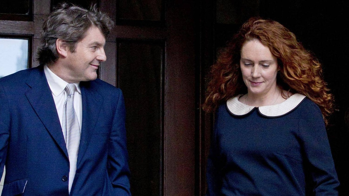 Rebekah Brooks, former chief executive of News International, and her husband Charlie Brooks leave the High Court in London after giving evidence to the Leveson Inquiry on May 11, 2012.