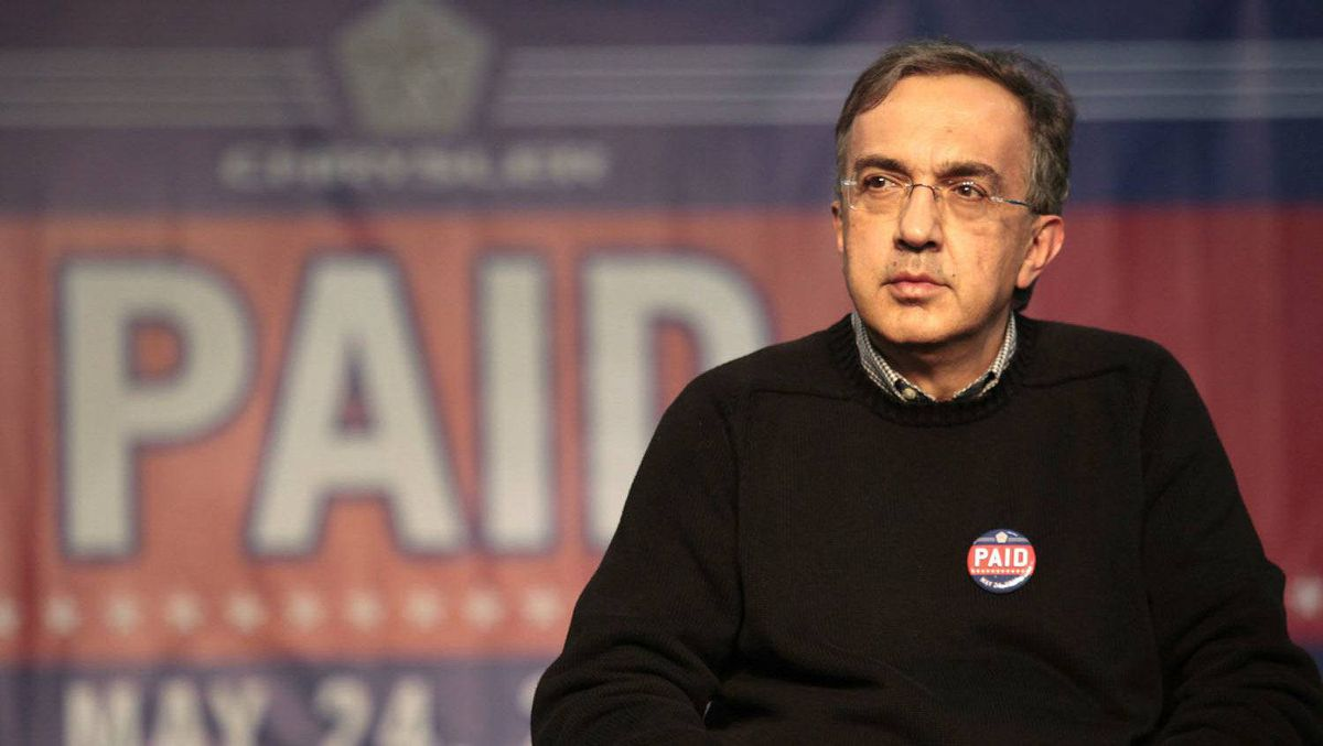 """Chrysler Group LLC Chief Executive Sergio Marchionne wears a """"Paid"""" button during a ceremony to celebrate Chrysler Group paying back its government loans to the U.S. and Canadian governments, at the Sterling Assembly plant in Sterling Heights, Michigan in this May 24, 2011"""