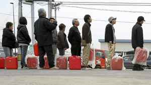 People in Fukushima line up for home heating fuel on March 20, 2011.