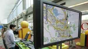 Hewlett-Packard employee Jamie El-Fattal , left, checks out the Google maps program during Google Developer Day 2007 in San Jose, Calif.