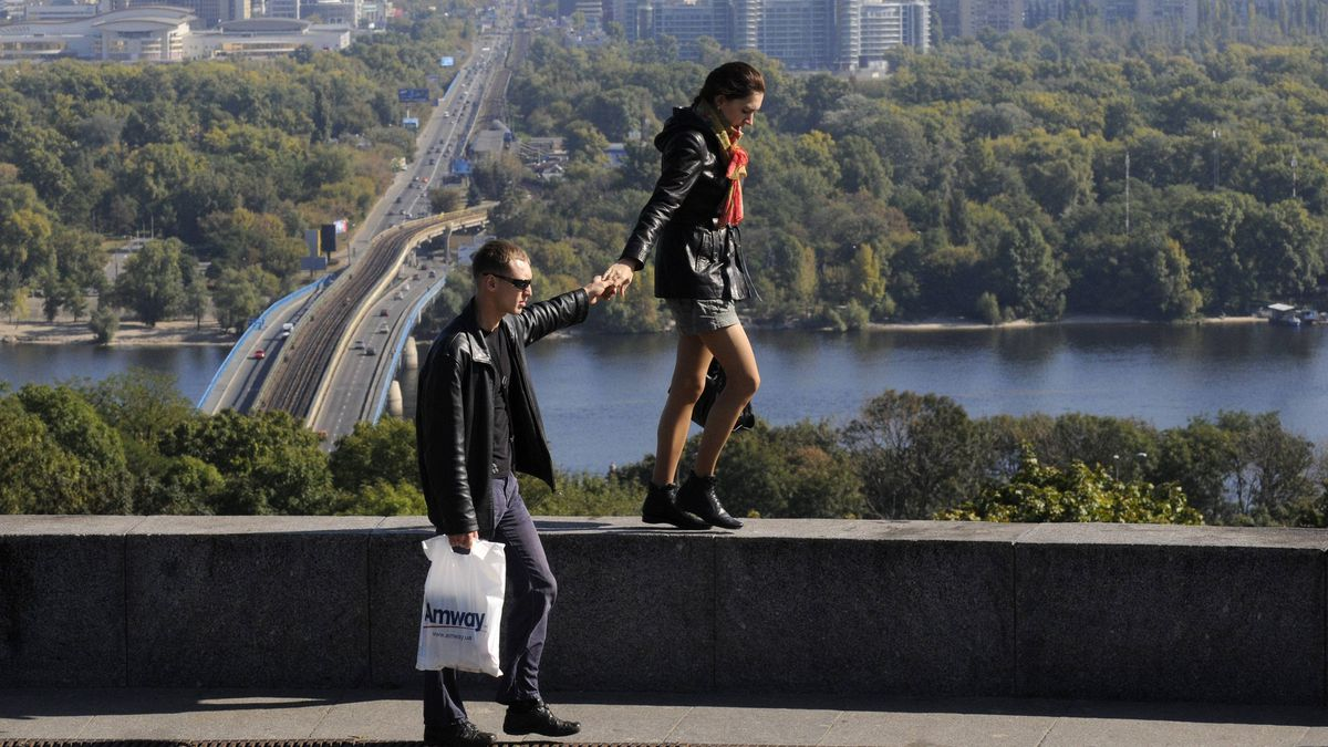People enjoy good weather in a city park in central Kiev, Ukraine, Monday,Sept. 26, 2011. Kiev is one of Ukraine's four host cities for the Euro 2012 soccer tournament.