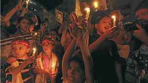 Palestinian children in Gaza City hold candles during a rally in solidarity with Palestinian prisoners held in Israeli jails, Oct. 13, 2011.