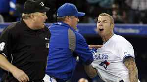 Toronto Blue Jays batter Brett Lawrie (R ) is held back by manager John Farrell during an argument with home plate umpire Bill Miller (L) after Lawrie was called out on strikes during the ninth inning of their MLB American League game against the Tampa Bay Rays in Toronto May 15, 2012.
