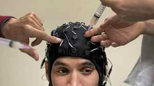 Daniel Abreu, a healthy control participant, is wired for a brain scan. In an effort to boost neurological research in the province, the Ontario Brain Institute is developing a giant repository of clinical information about the brain.