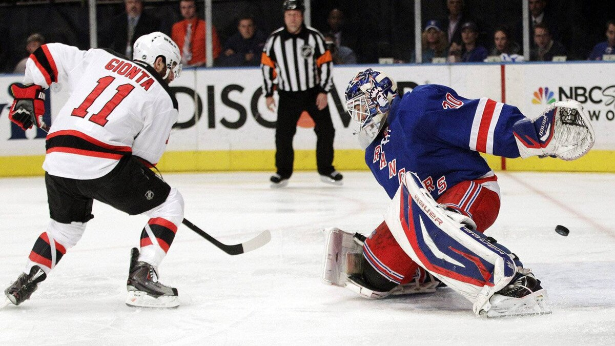 New Jersey Devils' Stephen Gionta (11) scores past New York Rangers goalie Henrik Lundqvist, of Sweden, during the first period of Game 5 of an NHL hockey Stanley Cup Eastern Conference final playoff series, Wednesday, May 23, 2012, in New York.
