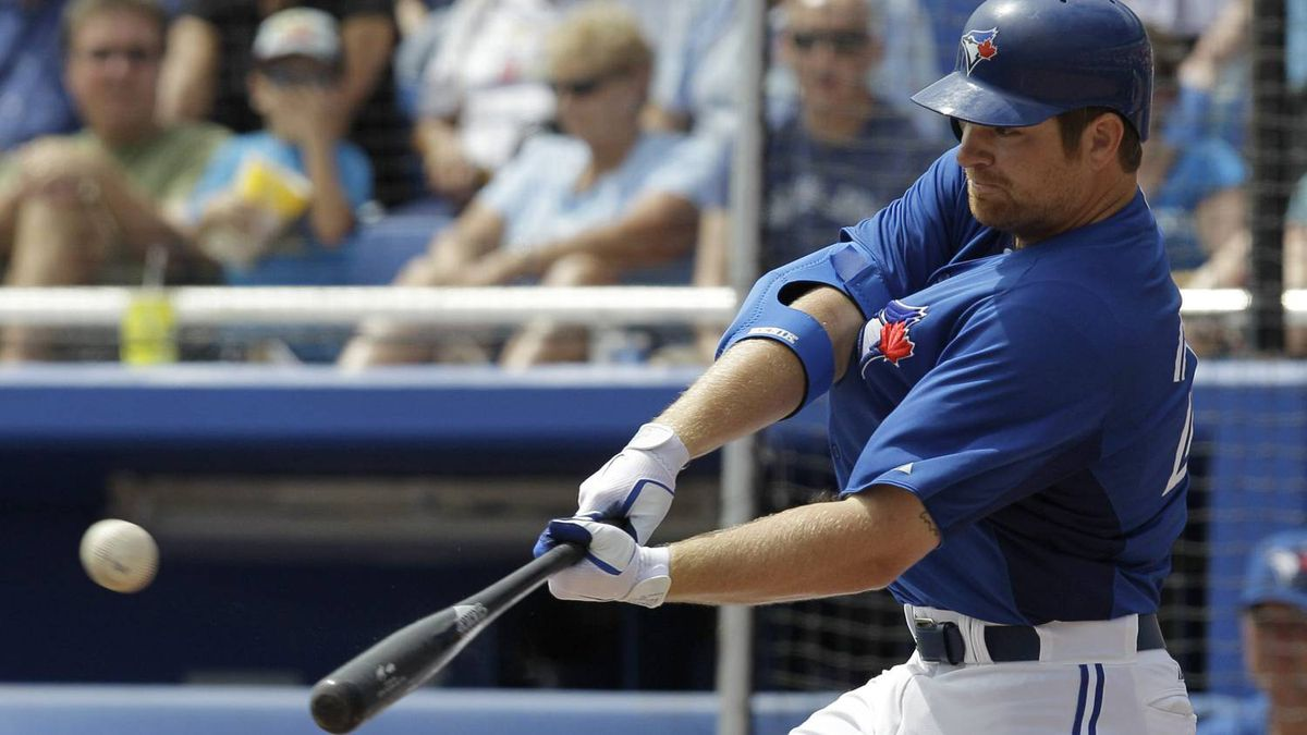 Toronto Blue Jays' Adam Lind hits a third-inning, three-run, home run off Atlanta Braves starting pitcher Randall Delgado during their spring training baseball game in Dunedin, Fla., Saturday, March 24, 2012. Yunel Escobar and Omar Vizquel scored on the home run. (AP Photo/Kathy Willens)