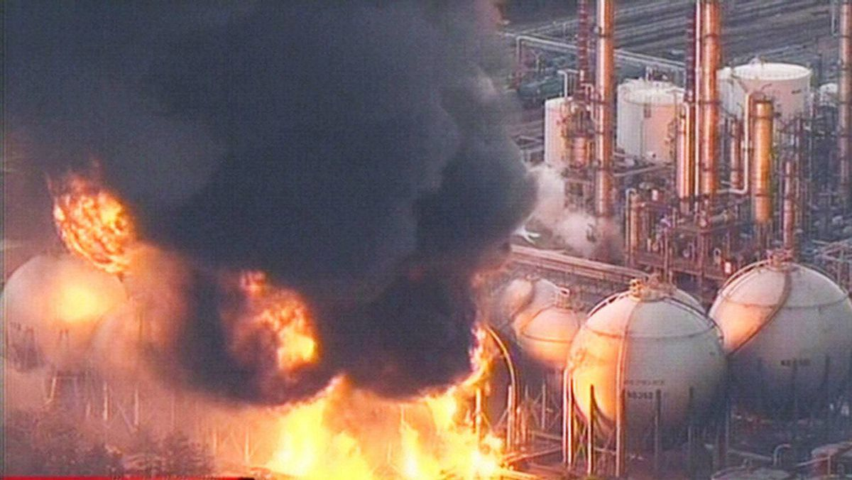 A screen grab taken from news footage by Japanese public broadcaster NHK shows a refinery on fire in Ishihara, Japan.