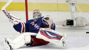 A shot by New Jersey Devils' Travis Zajac enters the net behind New York Rangers goalie Henrik Lundqvist, of Sweden, during the first period of Game 5 of an NHL hockey Stanley Cup Eastern Conference final playoff series, Wednesday, May 23, 2012, in New York.