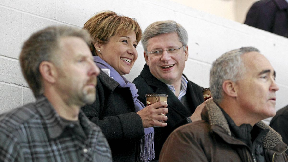 Canadian Prime Minister Stephen Harper and B.C. Premier Christy Clark look on as Clark's 10-year-old son Hamish plays during a minor league hockey game in Vancouver, Thursday Jan. 12, 2012.