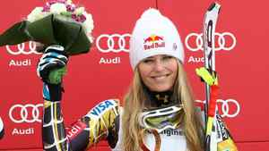 Lindsey Vonn, of the United States, celebrates on the podium her third place after completing a women's World Cup downhill on the Sochi Olympics course, in Krasnaya Polyana, near Sochi, Russia, Saturday, Feb.18, 2012. Vonn clinched her fifth consecutive World Cup downhill title Saturday, although German rival and friend Maria Hoefl-Riesch won the race on the 2014 Sochi Olympics course.