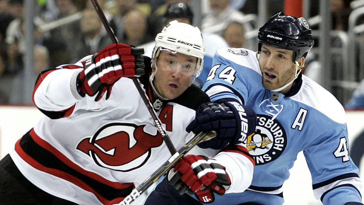 Ilya Kovalchuk of the New Jersey Devils battles through Brooks Orpik of the Pittsburgh Penguins at Consol Energy Center on December 6, 2010 in Pittsburgh, Pennsylvania.