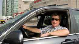 Paul Beeston, president and CEO of the Toronto Blue Jays Baseball Club and Rogers Centre, poses in his 2003 Acura 3.5 RL sedan.