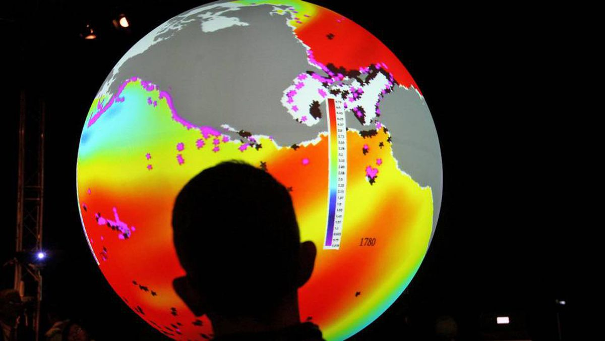 A spectator watches a climate-change-related projection at the UN climate conference in Copenhagen in December.