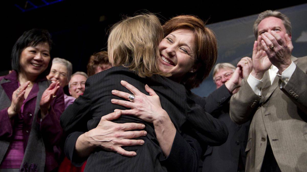 Premier-designate Christy Clark hugs her nine-year-old son Hamish at the BC Liberal convention in Vancouver after winning the leadership on Feb. 26, 2011.