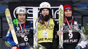 First-place finisher Mikael Kingsbury of Canada, center, poses with second-place finisher Patrick Deneen of the United States, left, and Philippe Marquis of Canada, third place, during a medal ceremony after the men's moguls World Cup freestyle skiing event in Wilmington, N.Y., on Thursday, Jan. 19, 2012.