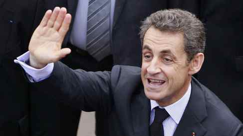 France's President Nicolas Sarkozy waves to supporters during a visit to Bordeaux on Tuesday.