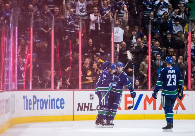 Canucks keep playoff hopes alive with 7-4 win over Senators
