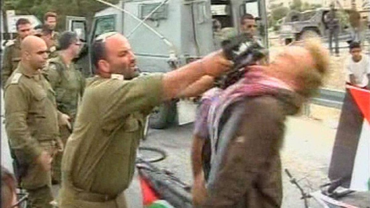 Israeli army Lieutenant-Colonel Shalom Eisner (2nd L) uses his M-16 rifle to strike Danish pro-Palestinian protester Andreas Las during a protest near the West Bank city of Jericho, in this frame grab from a video taken April 14, 2012 by Nablus TV.