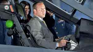 Defence Minister Peter MacKay checks out the cockpit of the F-35 Joint Strike Fighter in Ottawa on July 16, 2010.