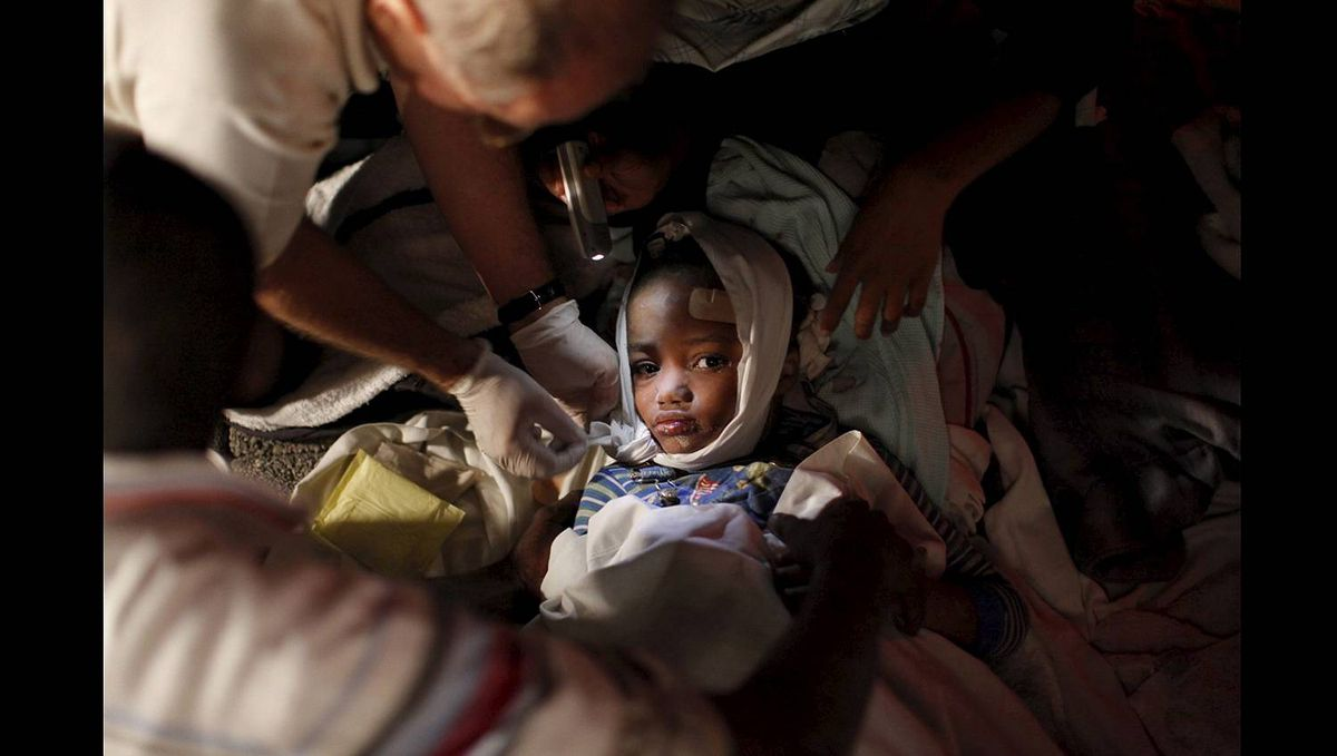 An injured child receives medical treatment after the earthquake in Port-au-Prince Jan. 13, 2010.