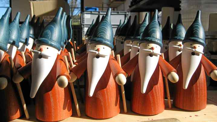 Handmade 'smoking Santas' ready to be finished in the Seiffener Volkskunst toy factory in Seiffen, Saxony, Germany.