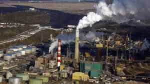 A Suncor oilsands mine facility seen from the air near Fort McMurray, Alta., Monday, Sept. 19, 2011. A European Union committee is set to vote Thursday on controversial new fuel quality guidelines that have prompted criticism and concern from supporters of Canada's oilsands. THE CANADIAN PRESS/Jeff McIntosh