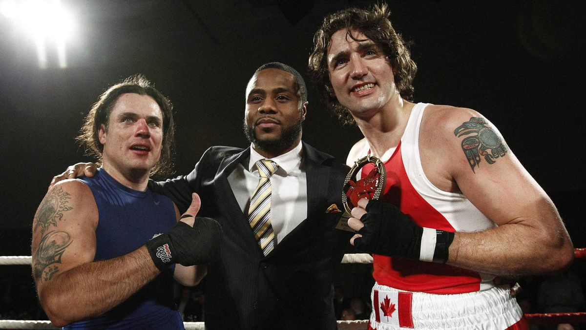 Liberal Member of Parliament Justin Trudeau (R) and Conservative Senator Patrick Brazeau (L) pose after Trudeau defeated Brazeau during their charity boxing match in Ottawa March 31, 2012.