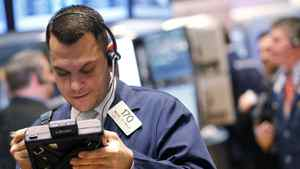Trader Michael Zicchinolfi works on the floor of the New York Stock Exchange, March 30, 2012.