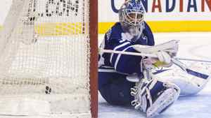Toronto Maple Leafs goaltender Jonas Gustavsson sits on the ice as the puck nestles in the back of the net after Philadelphia Flyers' Claude Giroux scores the winning shoot out goal in NHL hockey action in Toronto on Saturday March 10, 2012.THE CANADIAN PRESS/Chris Young