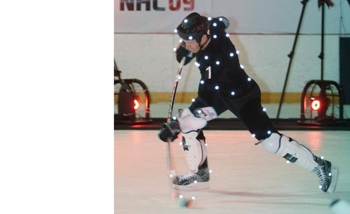 Calgary Flames' defenceman Dion Phaneuf shoots the puck during a motion capture event for a video game in Burnaby, British Columbia, September 9, 2008.