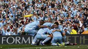 Manchester City's Pablo Zabaleta is mobbed by teammates after his goal during their English Premier League soccer match against Queens Park Rangers at the Etihad Stadium in Manchester, northern England, May 13, 2012.