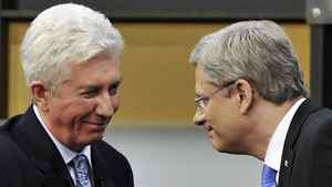 Bloc Quebecois Leader Gilles Duceppe, left, greets Conservative Party Leader and Prime Minister Stephen Harper after the French-language leaders' debate in the 2011 federal election.