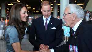 Catherine, Duchess of Cambridge, accompanied by her husband Prince William, shakes hands with Royal Canadian Navy veteran Lieutenant Kenneth Mathewson-Porter during a visit to the Canadian War Museum in Ottawa.