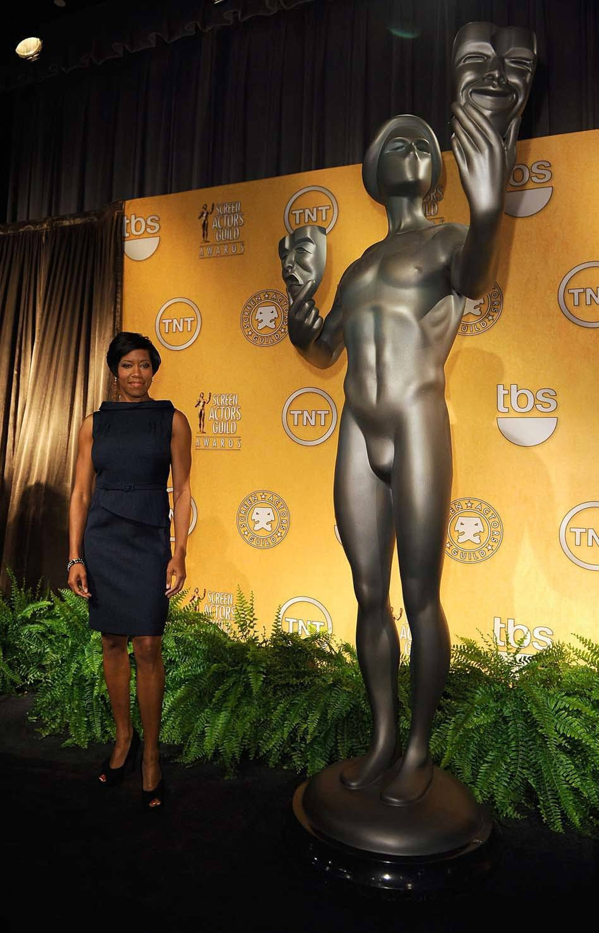 Finally, in Los Angeles last week, actress Regina King keeps a comfortable distance between herself and the giant, anatomically odd, Screen Actors Guild Award at the announcement of the SAG nominations in Los Angeles last week.