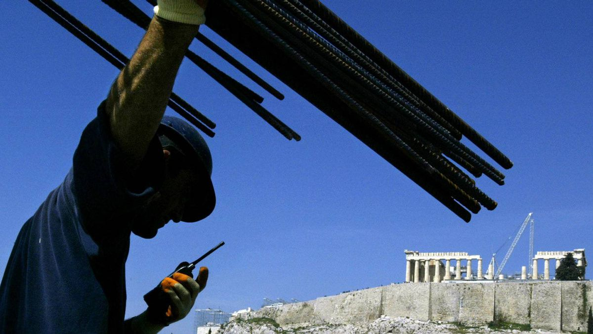 A construction worker directs work on the roof of the Acropolis Museum in Athens March 21, 2006.