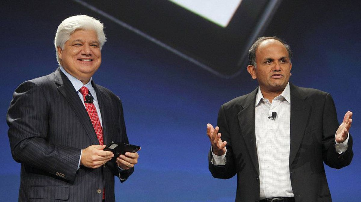 Mike Lazaridis, president and co-chief executive officer of Research in Motion, holds the new Blackberry PlayBook as President and Chief Executive Officer of Adobe Systems Incorporated Shantanu Narayen speaks at the RIM Blackberry developers conference in San Francisco, California September 27, 2010.