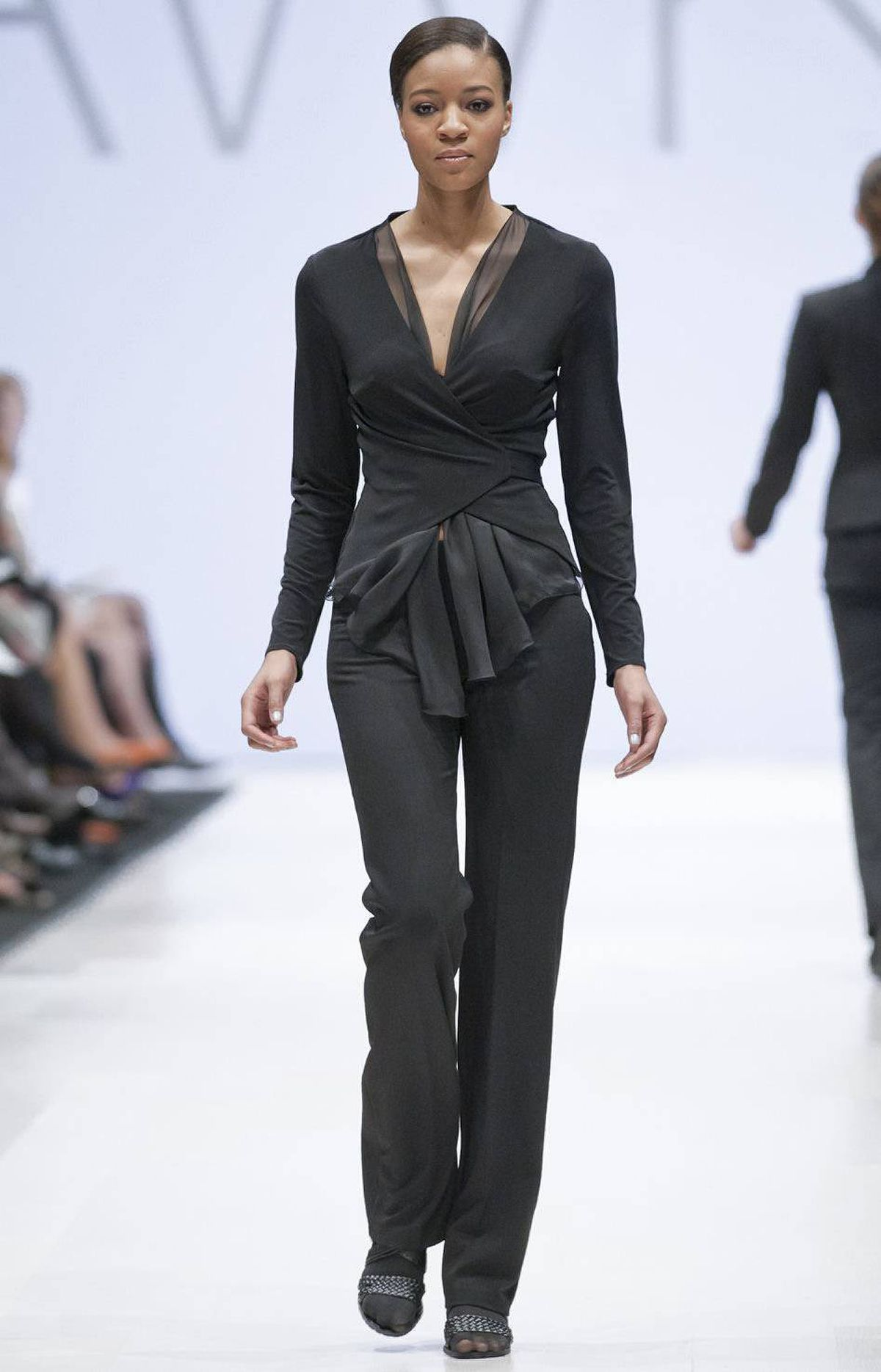 Earlier in the day, VAWK designer Sunny Fong also tried his hand at more-accessible fashion, introducing his label's new sister collection called VAWKKIN, featuring tailored, office-ready separates worn on the runway by real women the designer cast using an open call.