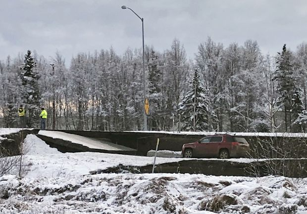 Photos of collapsed, cracked roads show the power of Alaska's quake