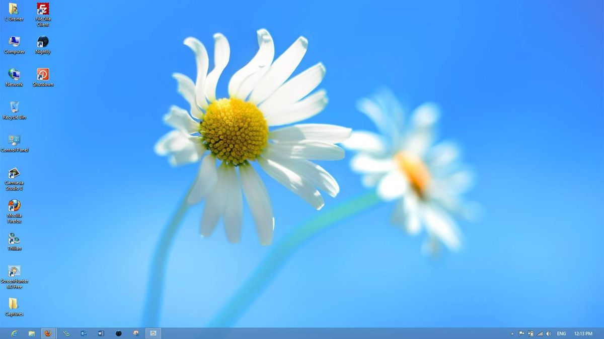 You may have noticed these pretty daisies in a tile on the Start screen. They're the default wallpaper for the Windows 8 Desktop app. From Desktop, you can run most Windows 7 software. It's almost the same as the Windows 7 desktop, with the exception of the missing Start button in the bottom left corner.
