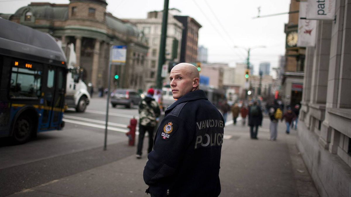 Constable Steve Addison patrols on foot through the Downtown Eastside in Vancouver recently.
