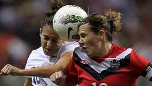 Canada's Christine Sinclair (12) and Carli Lloyd (10) fight for control of the ball with U.S.A. during the second half of CONCACAF women's Olympic qualifying final soccer action at B.C. Place in Vancouver, B.C., Sunday, Jan. 29, 2012. THE CANADIAN PRESS/Jonathan Hayward