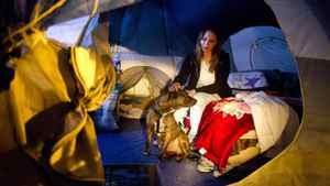 Andrea Sparre, who is studying to be a vet tech, with her dog Spike in her tent at the current site of the Nickelsville tent city in Seattle January 26, 2011.