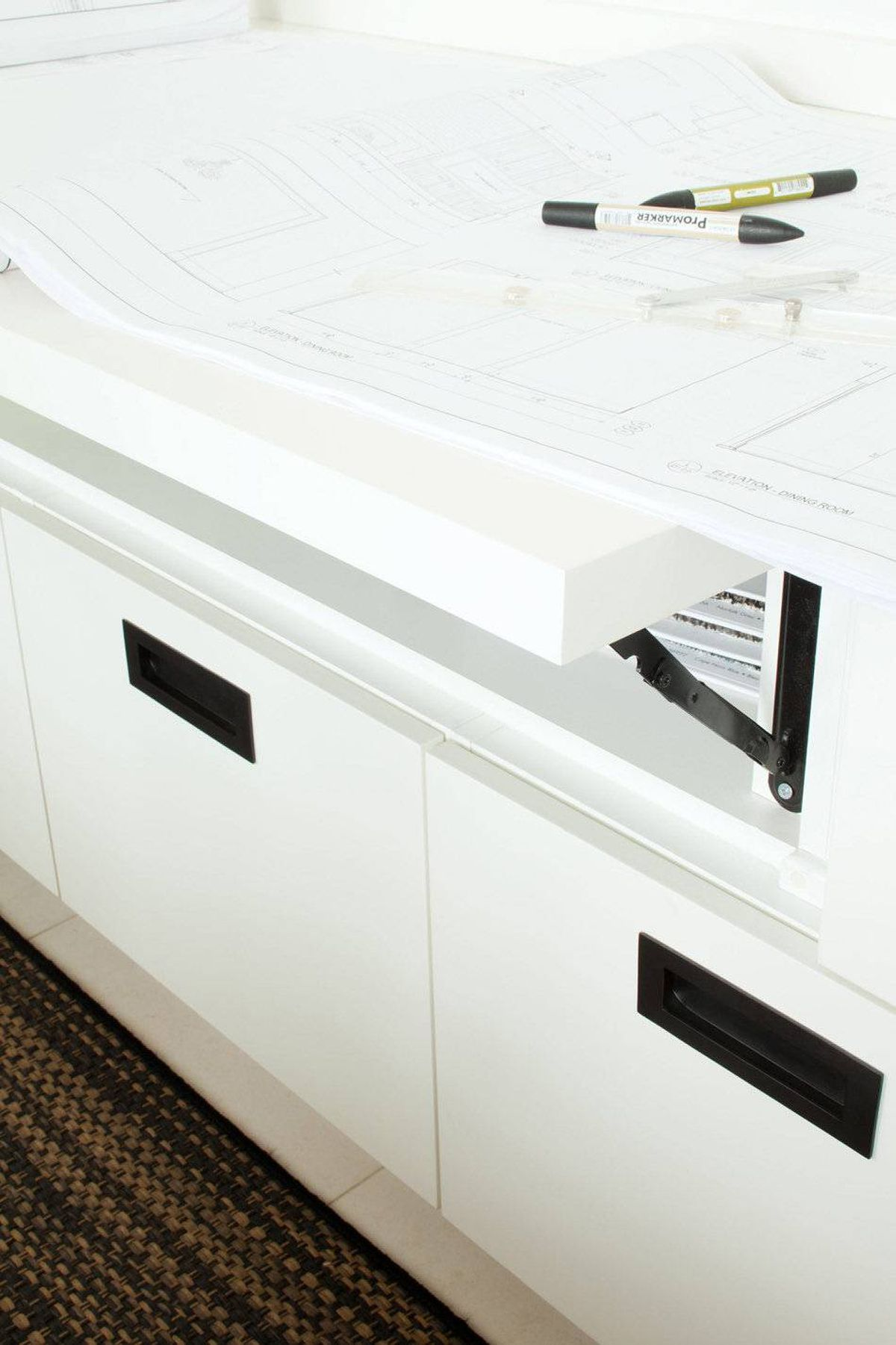 A flip-up countertop serves as a good surface on which to review architectural drawings.