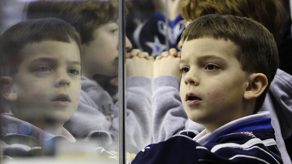 A boy watches the events on ice before hockey's NHL All-Star Game on Sunday, Jan. 30, 2011, in Raleigh, N.C. (AP Photo/Gerry Broome)
