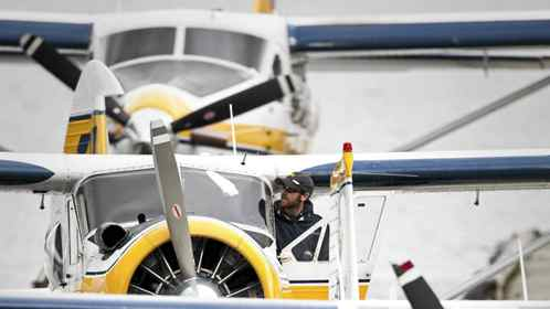 A member of Harbour Air's ground crew cleans the window of a floatplane in Vancouver's Coal Harbour June 3, 2010.