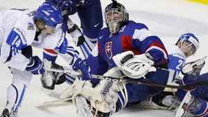 Team Finland's Roope Hamalainen, left, scores on Team Slovakia's goalie Juraj Simboch, centre, during first period IIHF World Junior Championships quarter-final hockey action in Calgary, Alta., Monday, Jan. 2, 2012.THE CANADIAN PRESS/Jeff McIntosh